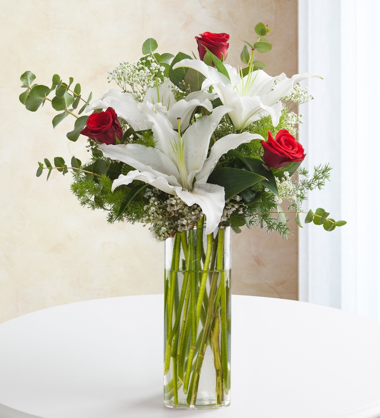 Hidden dreams roses and lilies kc143583 bouquet of 2 white lilies and 3 red roses izmirmasajfo