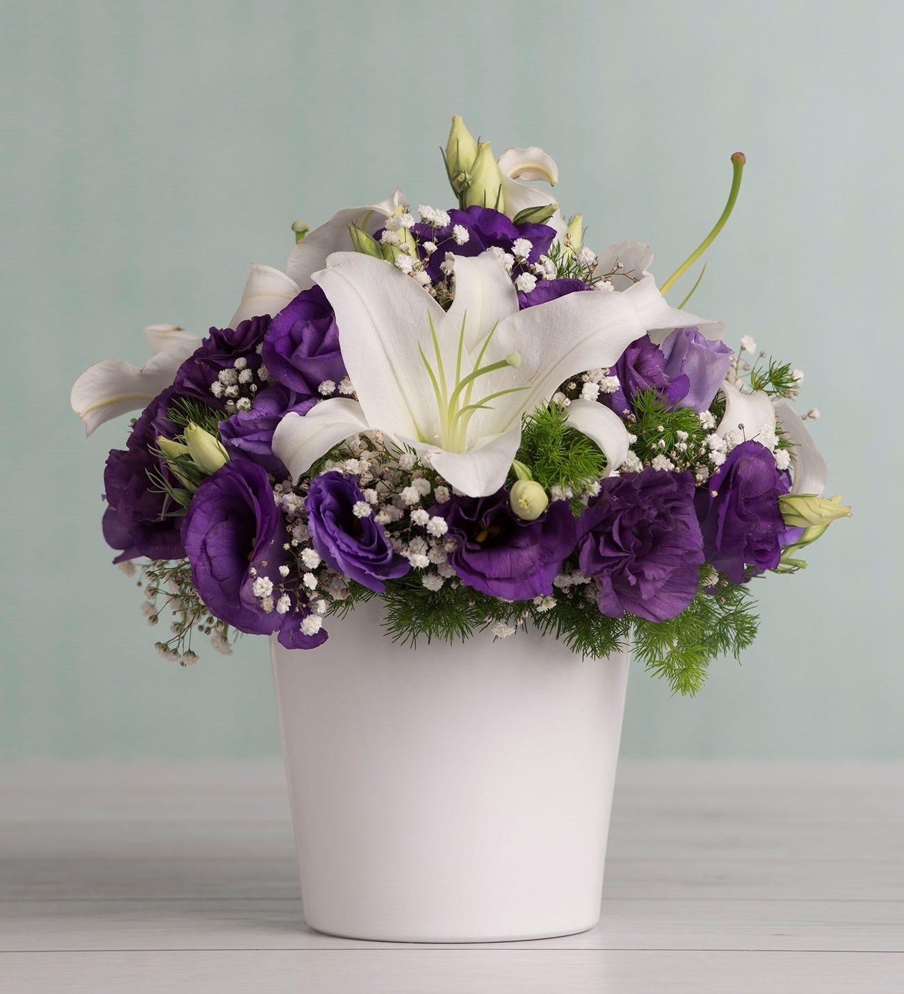 Lilies and purple lisianthus vibrant hug izmirmasajfo